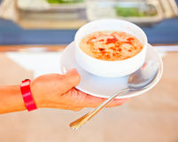 Hand holding soup Stock Image