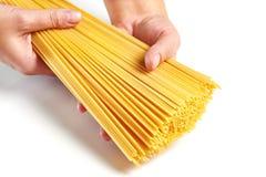 Hand holding spaghetti isolated Stock Photos
