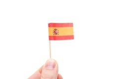 Hand holding spanish flag Royalty Free Stock Photos