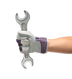 Hand holding spanner Royalty Free Stock Image