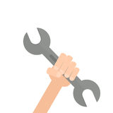 Hand holding spanner Stock Images