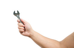 Hand holding a spanner Royalty Free Stock Photography