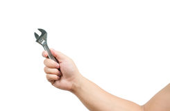 Hand holding a spanner Royalty Free Stock Image
