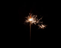 hand holding a sparkler fire on black background Royalty Free Stock Images