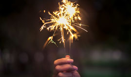 Hand holding sparklers Royalty Free Stock Photography