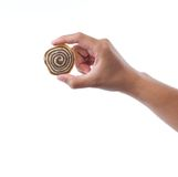 hand holding spiral cookie Royalty Free Stock Image