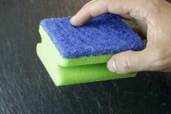 Hand holding a sponge stock image