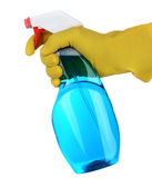 Hand Holding a Spray Bottle of Cleanser. Closeup of a plastic spray bottle of cleaner being held by a hand wearing a yellow latex glove. Vertical format isolated Stock Photos