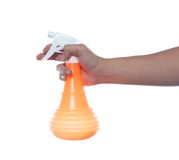 Hand holding spray bottle Royalty Free Stock Images