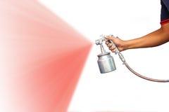Hand holding spray gun royalty free stock image