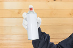 Hand holding spray paint can Stock Image