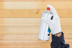 Hand holding spray paint can Stock Photos