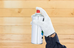 Hand holding spray paint can Royalty Free Stock Photo