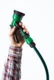 Hand holding a sprinkler hose Stock Image