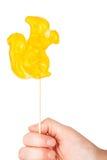 Hand holding squirrel shape lollipop Stock Image