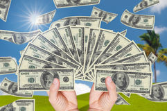 Hand holding stack of 100 dollars. With beautiful background Stock Image