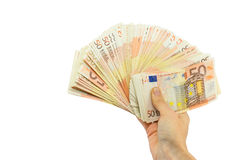 Hand holding stack of fifty euro notes on white Royalty Free Stock Photos
