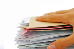 Hand holding stack of files Stock Images