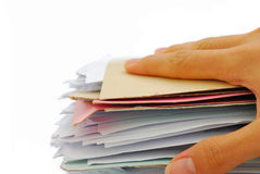 Hand holding stack of files Royalty Free Stock Photo
