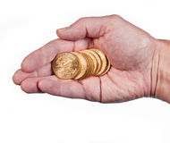 Hand holding a stack of gold coins. Male hand holding a stack of pure gold eagle coins royalty free stock photography