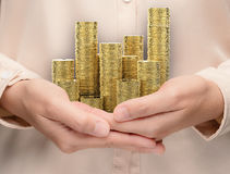 Hand holding stack of gold coins Stock Photos