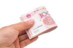 Hand holding stack or RMB Stock Image