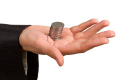 Hand holding a stack of silver coins Royalty Free Stock Images