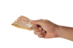 Hand holding a stack of singapore dollars Royalty Free Stock Photography