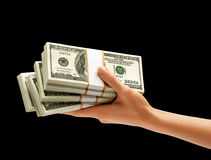 Hand holding Stacks of dollars Stock Image