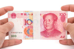 Hand holding stacks of 100 RMB paper currency with clipping path Royalty Free Stock Images