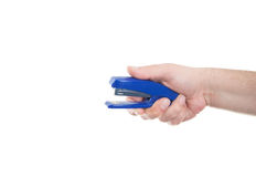 Hand holding stapler Stock Images