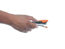 Hand holding stapler Royalty Free Stock Images
