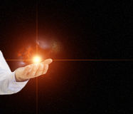 Hand holding a star with nebula Royalty Free Stock Photos