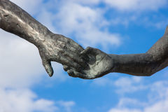 Hand holding statues Stock Photography