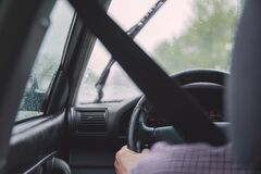 Hand holding steering wheel Stock Images