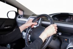 Hand holding steering wheel in modern private car with blank win. Hand holding steering wheel in modern private car with blank white windshield Royalty Free Stock Photos