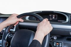 Hand holding steering wheel in modern private car with blank win. Hand holding steering wheel in modern private car with blank white windshield Royalty Free Stock Image