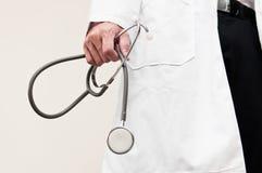Hand holding stethoscope Stock Image
