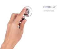Hand holding a stethoscope isolated on white background with cli Stock Photo