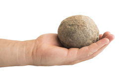 Hand holding stone ball royalty free stock photography