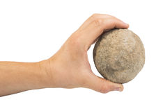 Hand holding stone ball Stock Images