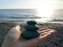 Hand holding stones. Stock Photos
