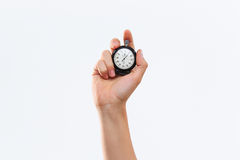 Hand holding a stopwatch against a white background royalty free stock photos