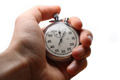 Hand holding stopwatch Stock Images