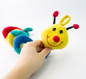 Hand holding a strange cute toy Stock Photos