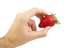 Hand holding a strawberry isolated on white. Stock Photo