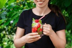 Hand holding strawberry lemonade Royalty Free Stock Photo