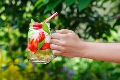 Hand holding strawberry lemonade Stock Image