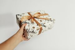Hand holding stylish christmas present isolated. giving box. gif Royalty Free Stock Photography