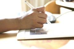 Hand holding stylus pen Stock Image